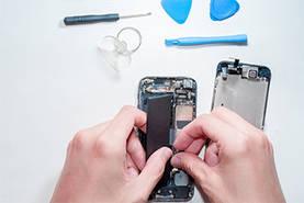 somebody repairing a smartphone